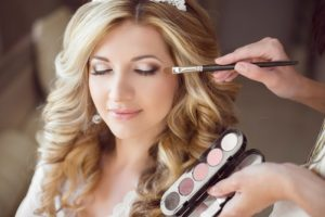 Beautiful Bride Girl With Wedding Makeup And Hairstyle. Stylist